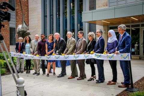 University of Michigan-Dearborn celebrates the opening of the Natural Sciences Building. On hand to cut the ribbon were Department of Natural Sciences Chair John Thomas, Student Government President Fiana Arbab, Staff Senate Chair Bryan Earl, Biology Club President Ekene Ezeokoli, Psychology Professor and Faculty Senate Chair Nancy Wrobel, Chancellor Daniel Little, Physics and Astronomy Interim Chair Don Bord, College of Arts, Sciences, and Letters Dean Marty Hershock, Provost Kate Davey, State Representative George Darany, Chemistry Club President Latifa Dabaja and alumnus Eric Nemeth. (Photo: Business Wire)