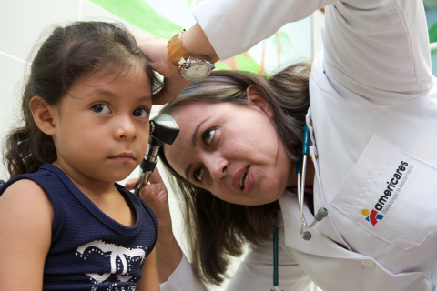 Pediatrician Dr. Helene Gutierrez examines a patient at the Americares Family Clinic in Santiago de Maria, El Salvador. Photo by Marc Birnbach/Americares