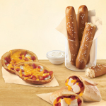 The DQ system introduces new DQ Bakes!® Snacks Menu with soft pretzels with zesty queso, potato skins and snack melts – all offered under $2 for a limited time at participating locations. (Photo: Business Wire)