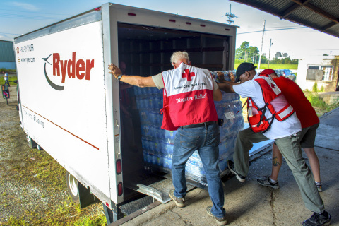 American Red Cross workers load disaster relief items onto a Ryder Rental truck. (Photo: Business Wire)