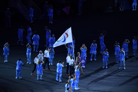 Agência Brasil/Ibrahem Al Hussien carries the International Paralympic flag at the opening ceremony ...