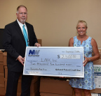 Chris McDonald, President and CEO of Northwest Federal presents a check from the 3rd annual Summertime Food Drive to Lisa Lombardozzi, President of LINK, Inc.'s Board of Directors. (Photo: Business Wire)