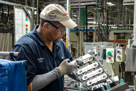 """Henry """"Sonny"""" Smith, a Toyota West Virginia team member for 17 years, inspects the cam housing on a four-cylinder engine. (Photo: Business Wire)"""