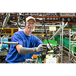 Marc Rumer works on the six-cylinder engine final assembly line at Toyota West Virginia. Rumer has been a team member at the Buffalo plant since 2000. (Photo: Business Wire)