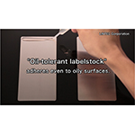 Oil-tolerant labelstock adheres even to oily surfaces (Photo: Business Wire)