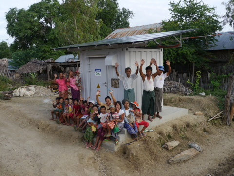 Image of Power Supply Station and the villagers (Photo: Business Wire)