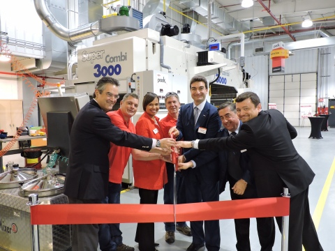 Ribbon Cutting Ceremony at Dow's Ringwood, Ill. Pack Studios. Pictured; Diego Donoso, President Dow Packaging and Specialty Plastics; Jeff Huizenga, Lab Technician for Dow; Karen S. Carter, North America commercial vice president for Dow Packaging and Specialty Plastics; Bill Parks, Pilot Coater Facility Manager for Dow; Vincenzo Cerciello, Nordmeccanica N.A. president; Giancarlo Caimmi, Commercial Director for Nordmeccanica; Laurent Remy, Global Business Director, Adhesives and Functional Materials, Dow Packaging and Specialty Plastics. Photo Credit: Dow Packaging and Specialty Plastics