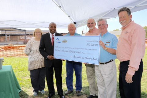 The Downtown Revitalization and Improvement Volunteer Effort (D.R.I.V.E.) received a $16,000 Partnership Grant Program award from Merchants and Planters Bank and FHLB Dallas. Newport, Arkansas, Mayor David Stewart was in attendance. (Photo: Business Wire)