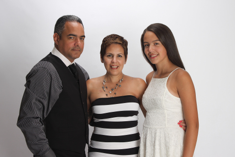 Evelyn Ortiz, Chief Talent Officer at Zoetis, is the company's 2016 Working Mother of the Year. She is pictured here with her husband, Victor and daughter, Rosie. (Photo: Zoetis)