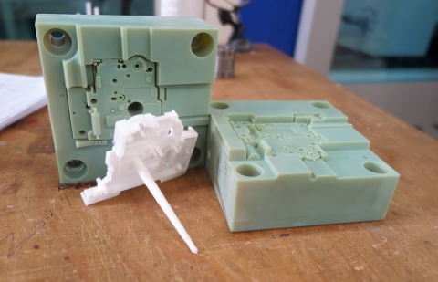 3D printed injection mold with resulting part, produced on a Stratasys Objet Connex 3D Printer (Photo: Business Wire).