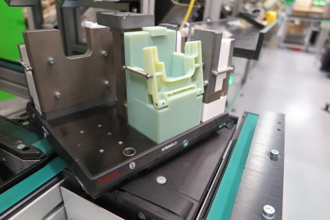 A 3D printed jig, produced using a Stratasys Objet Connex 3D Printer, enables quick functional tests and required design iterations on the production line (Photo: Business Wire).