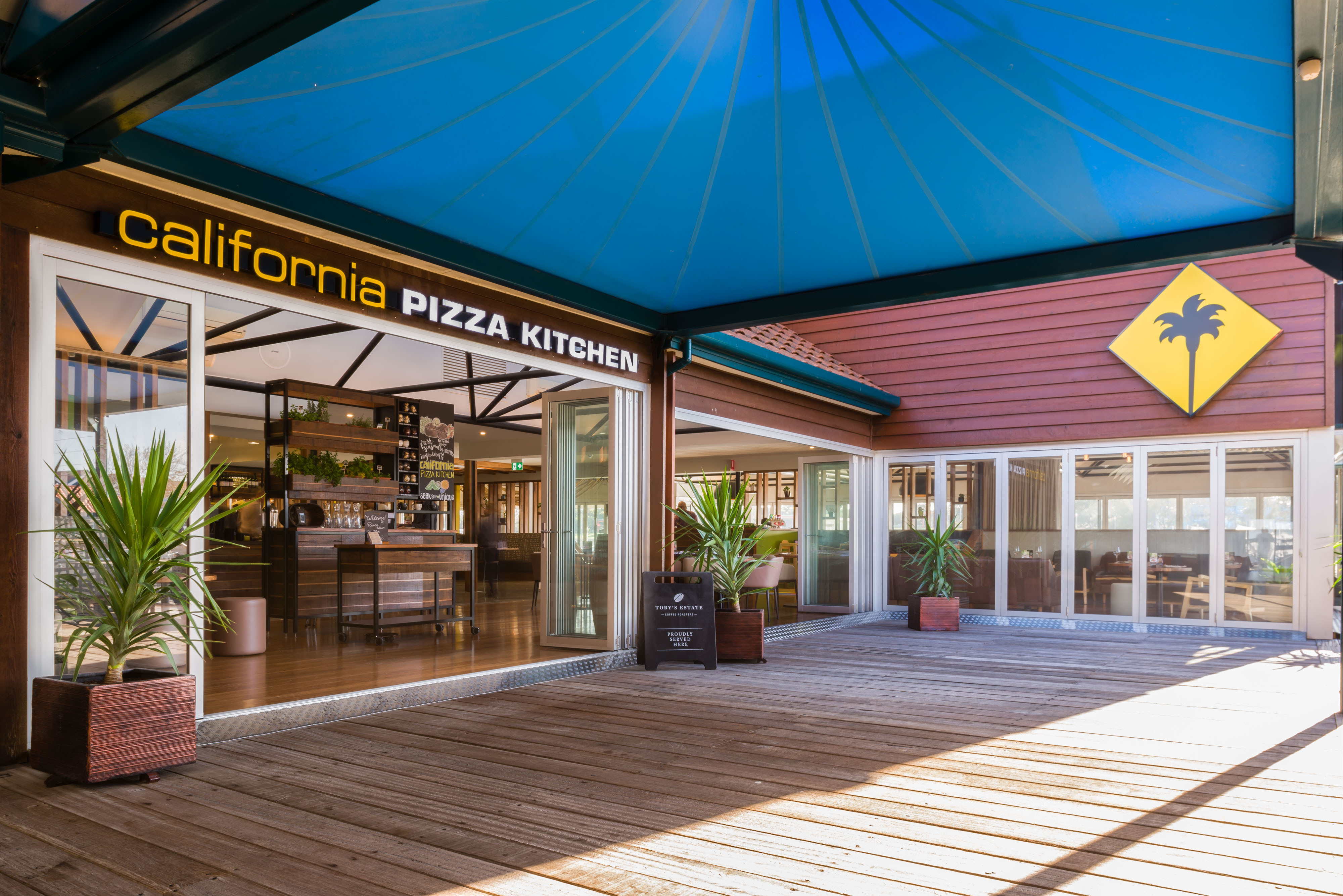 Pizza Kitchen Design california pizza kitchen opens first location in australia