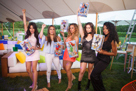 "The members of Fifth Harmony celebrate the premiere of their DC Super Hero Girls ""That's My Girl"" music video collaboration by striking a pose with their favorite DC Super Hero Girls Action Doll. (Photo Cred: Warner Bros Consumer Products and DC Entertainment / Product Cred: Mattel)"