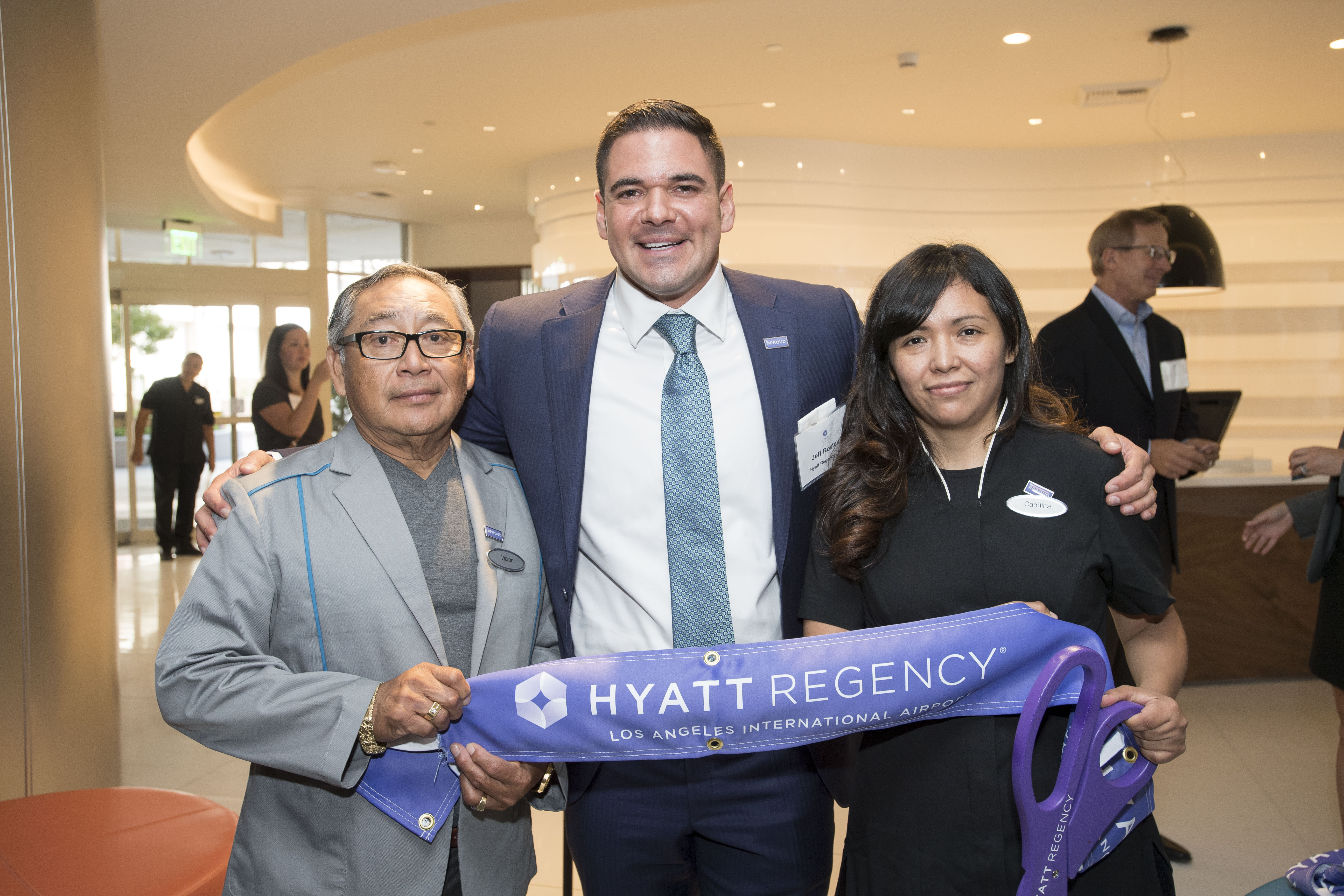 A ribbon cutting ceremony marks the brand transition of The Concourse Hotel at Los Angeles Airport, a Hyatt affiliated hotel, to Hyatt Regency Los Angeles International Airport. Shown from left to right are Victor Estrella, the longest tenured employee who has worked at the hotel for 37 years, Jeff Rostek, the hotel's managing director, and Carolina Barrera, the most recently hired employee. (Photo: Business Wire)