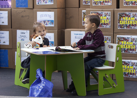 Two-year-old Brinlee and her five-year-old brother, Eli, test out the new UnitedHealthcare Children's Foundation reading station donated by UnitedHealthcare along with 100 books to support Catalyst's Children's Program. The donation was made as UnitedHealthcare employees in Chico, Calif., donated more than 3,000 pounds of food and everyday necessities to Catalyst Domestic Violence Services' emergency shelter in Butte County (Photo: Brian Peterson).