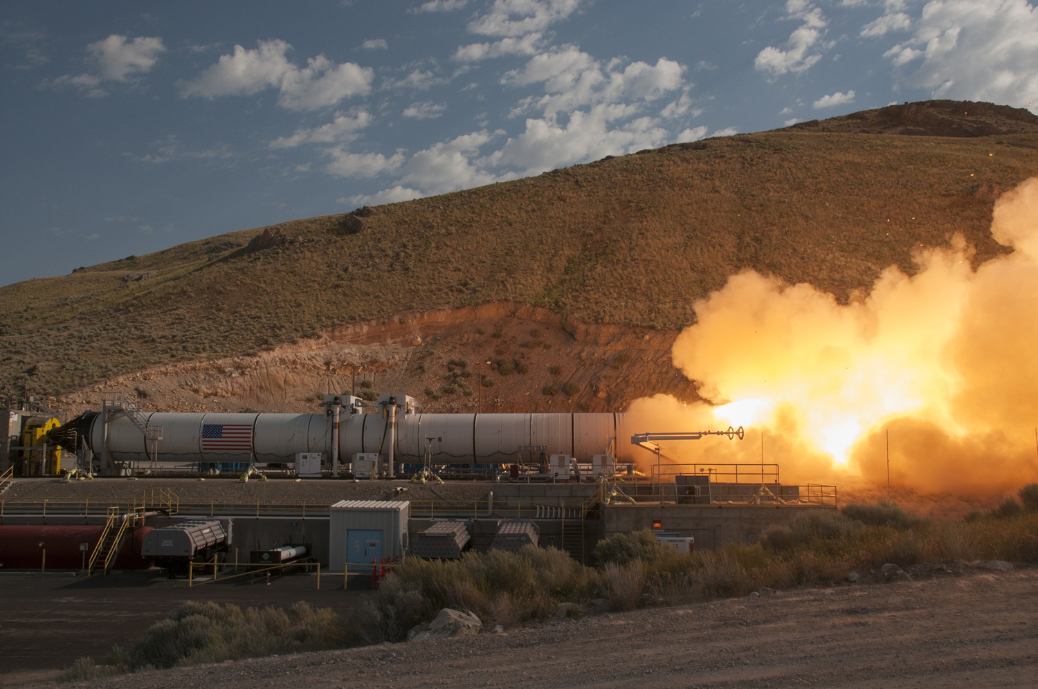 This Orbital ATK-manufactured, full-scale solid rocket booster qualification test motor blasted 3.6 million pounds of thrust during the two minute test in June. Two boosters will provide initial thrust to boost the SLS and Orion off the launch pad. (Photo: Business Wire)