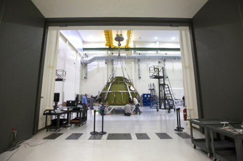 Lockheed Martin engineers and technicians prepare the Orion pressure vessel for a series of tests inside the proof pressure cell in the Neil Armstrong Operations and Checkout Building at NASA's Kennedy Space Center in Florida. (Photo: Business Wire)