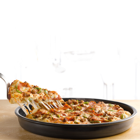 Each Pan Pizza is layered with high-quality toppings of choice and covered with Papa John's signature cheese all the way to the edge of the specially crafted, caramelized cheese crust. (Photo: Business Wire)