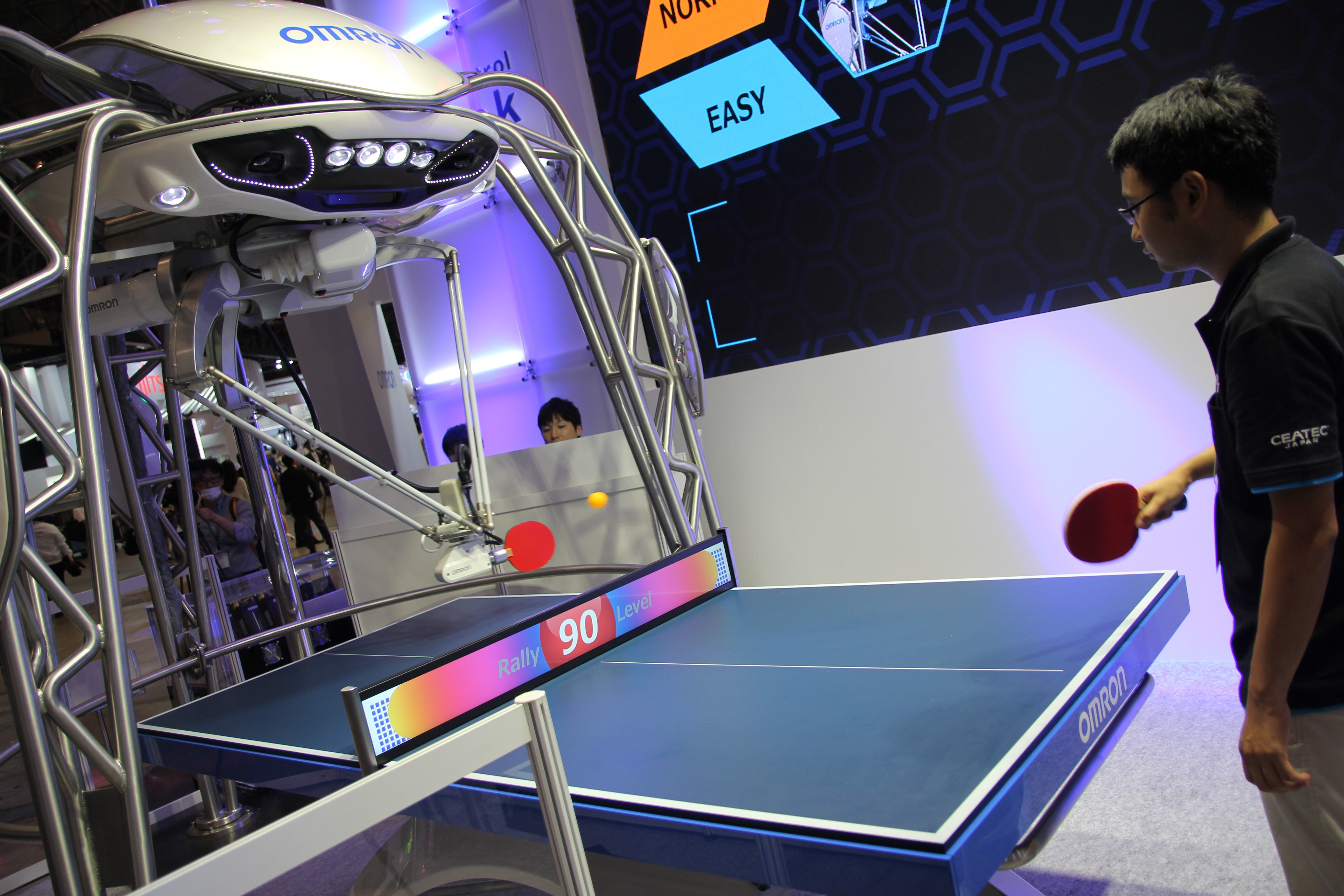 OMRON Corporation held a Guinness World Record certification ceremony for the Omron table tennis robot FORPHEUS, certified as the first robot table tennis tutor by Guinness World Records, at CEATEC JAPAN 2016 on October 3, 2016. (Photo: Business Wire)