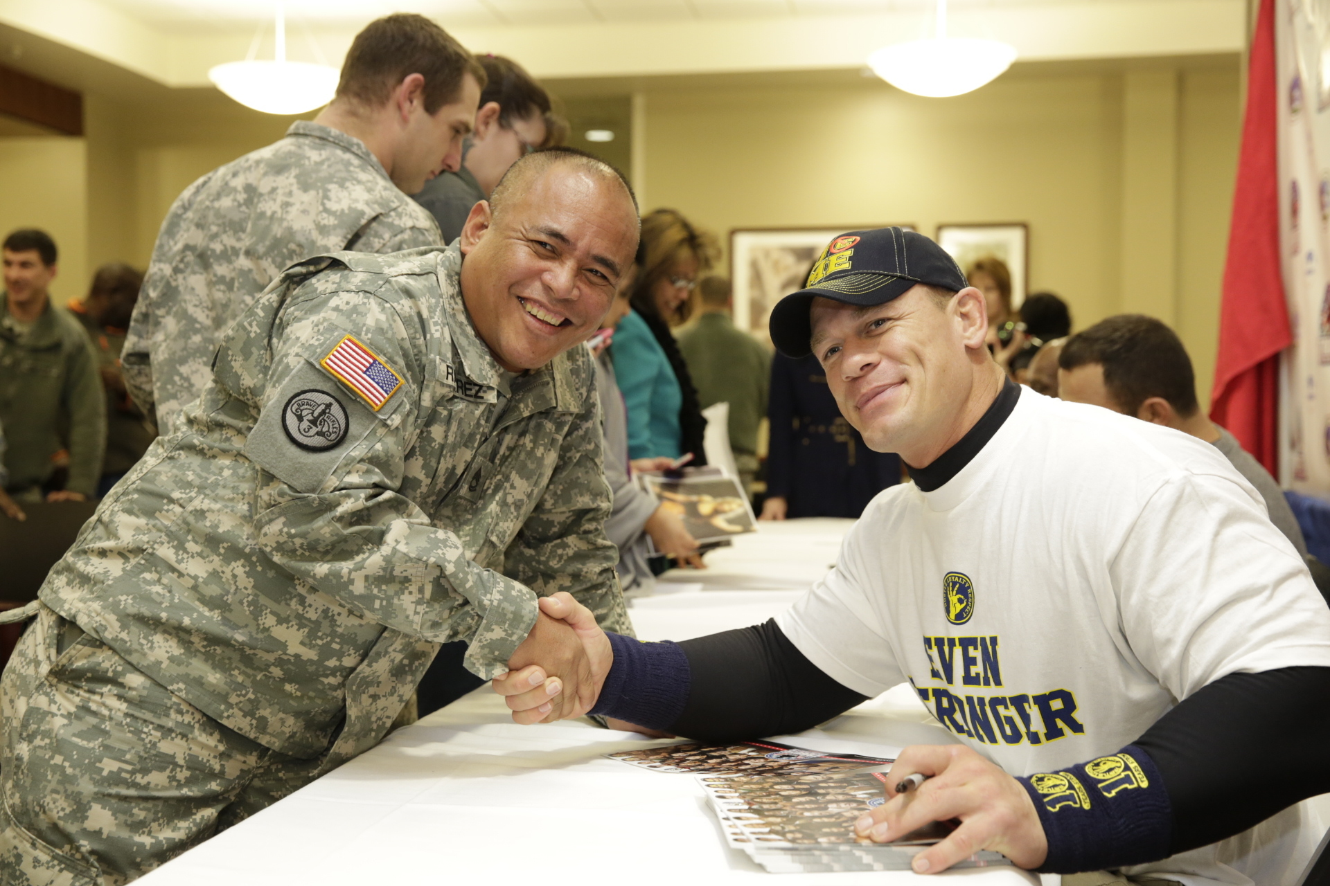 WWE Superstar John Cena greets our nation's troops. (Photo: Business Wire)