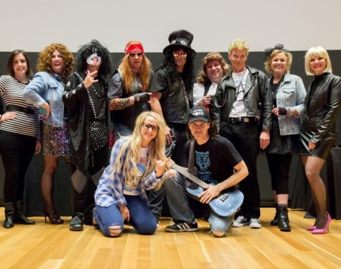 """Presenters dressed up as their favorite rock stars at the 2016 """"Elevate Live"""" themed town hall. (Photo: Business Wire)"""
