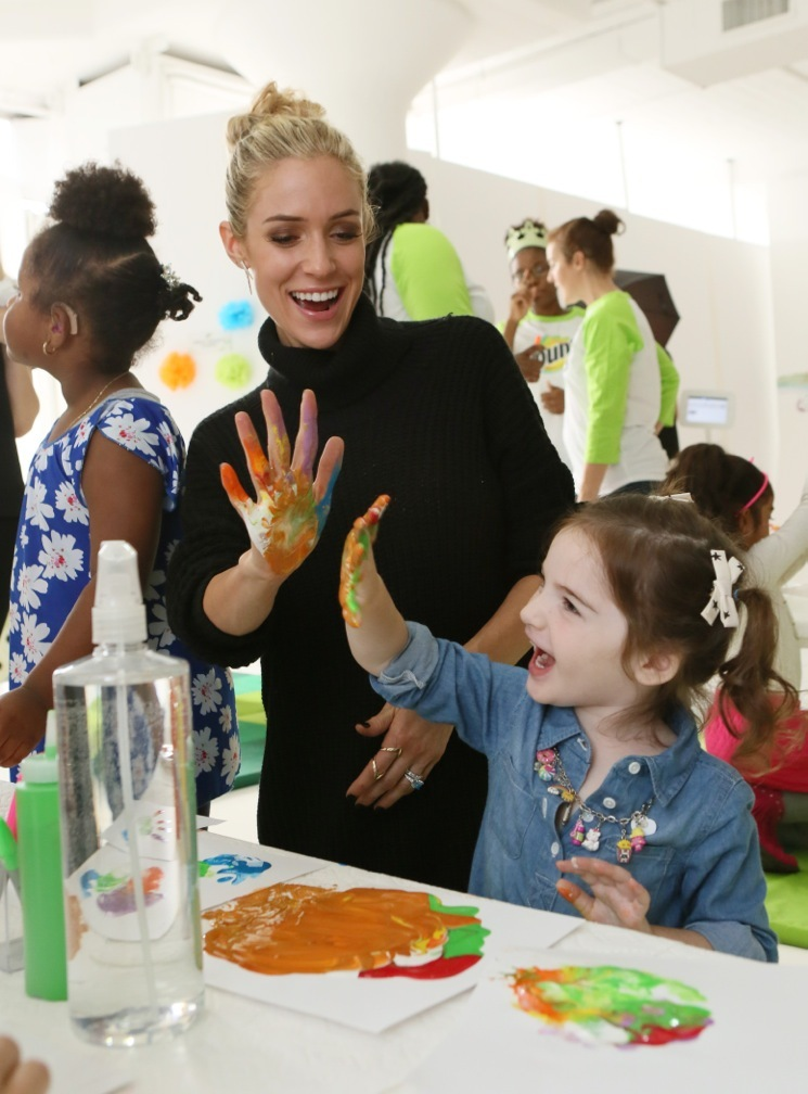 """Kristin Cavallari, mother, designer and New York Times Best-selling author, gets messy with attendees at Bounty's Memorable First Moments """"First Birthday Bash"""" on Thursday, October 13, 2016 in New York. (Photo by Stuart Ramson/Invision for Bounty/AP Images)"""
