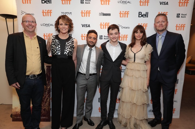 "Col Needham, Founder and CEO of IMDb, and the stars, director and writer of Focus Features' ""A Monster Calls,"" taken at the film's world premiere at the 2016 Toronto International Film Festival. From left to right: IMDb's Col Needham, Sigourney Weaver, director J.A. Bayona, Lewis MacDougall, Felicity Jones, and screenwriter Patrick Ness. (Photo: Business Wire)"