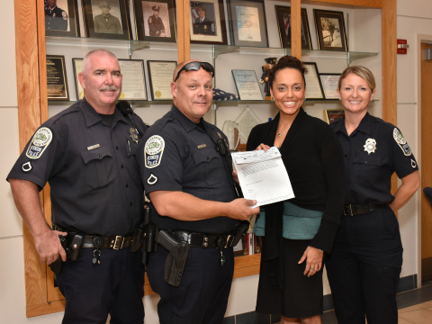Edward Stapleton, Ronald Eicke, and Denise Randles of the Herndon Police Department with Alexzandra Shade, Executive Director of the NWFCU Foundation (Photo: Business Wire)