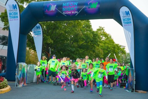 Runners of all ages take off down the course at the NWFCU Foundation's 2nd annual Neon Night Glow Run (Photo: Business Wire)