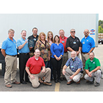 Standing-Left to right: David Neighbors, Dale Innis of Liberty Mutual, Bobby Wilson, Hope Lutrell, Mary Pierce, Rachell Boudreau, John Oliver, Jim Rison and Jeremy Dogan. Kneeling-Left to right: Sean Graddy, Scott Maxwell and Joe Upchurch (Photo: Business Wire)