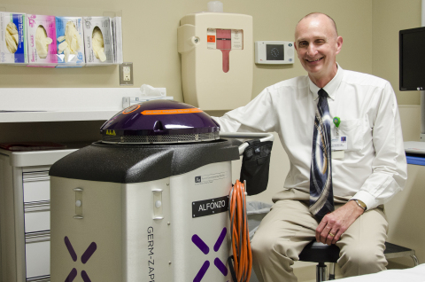Stopping infections starts with killing the superbugs that cause them. Genesis Healthcare has deployed a Xenex Germ-Zapping Robot to destroy the germs and bacteria that pose a risk to patient safety. Daniel Scheerer, M.D., Chief Medical Affairs Officer for Genesis, poses with the hospital's new robot. (Photo: Business Wire)