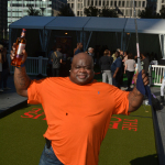 "Former Eagle Hollis Thomas celebrates helping set a Guinness World Record at an event to establish ""the world's largest putting green"" at Dilworth Park at City Hall Tuesday. The 104 foot and 2 inch putting green  installed at Dilworth became certified as the world's longest by a representative of the Guinness Book of World Records. The event was sponsored by The Famous Grouse, Scotland's number one Scotch. (Photo: Mark C. Psoras)"