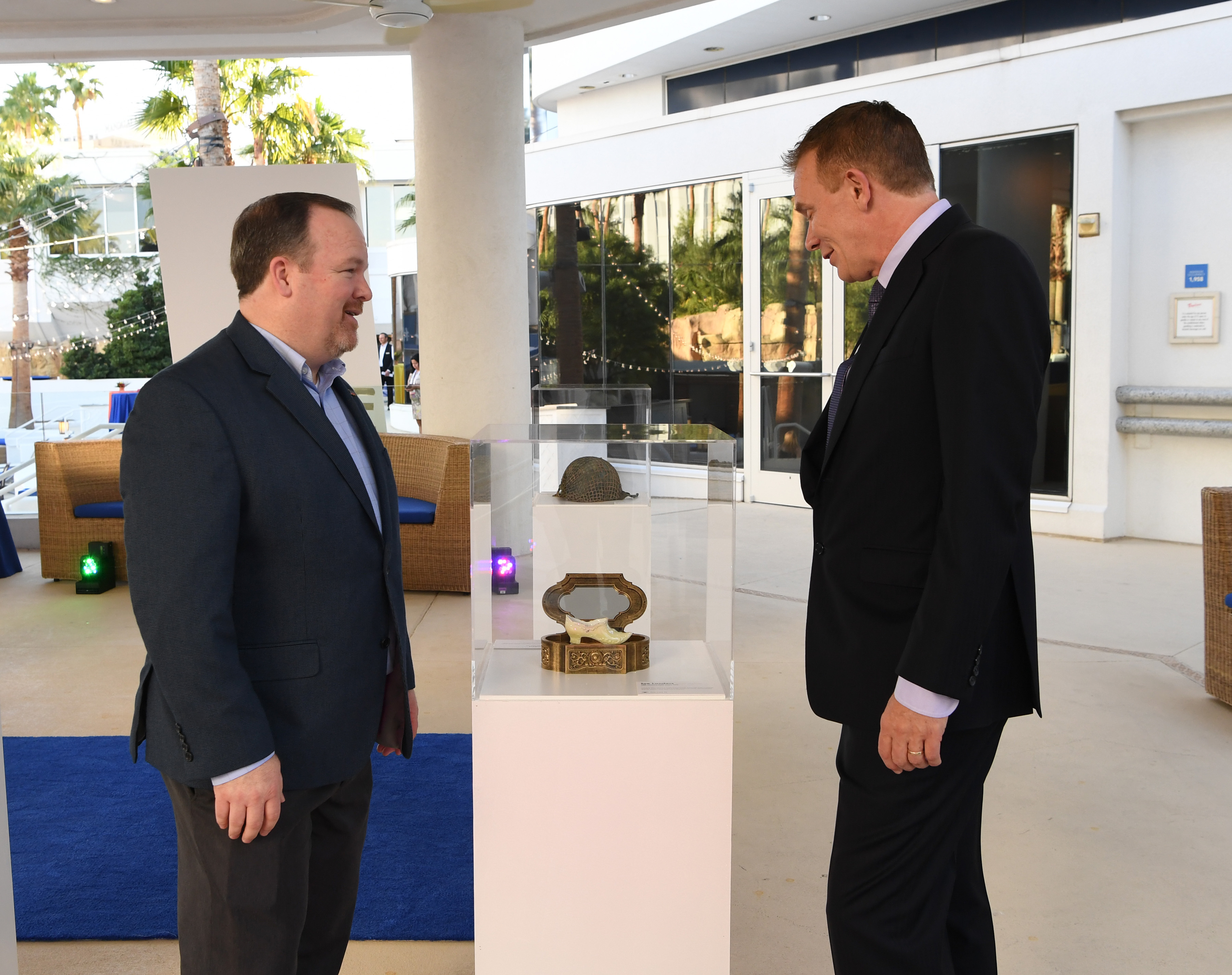 Hilton vice president of marketing Andrew Flack discusses WowMakers initiative with honoree Joe Landers at the Hilton Museum of Wow exhibit on Oct. 18, 2016 at the Hilton Tropicana Hotel in Las Vegas. (Denise Truscello /Getty Images for Hilton)