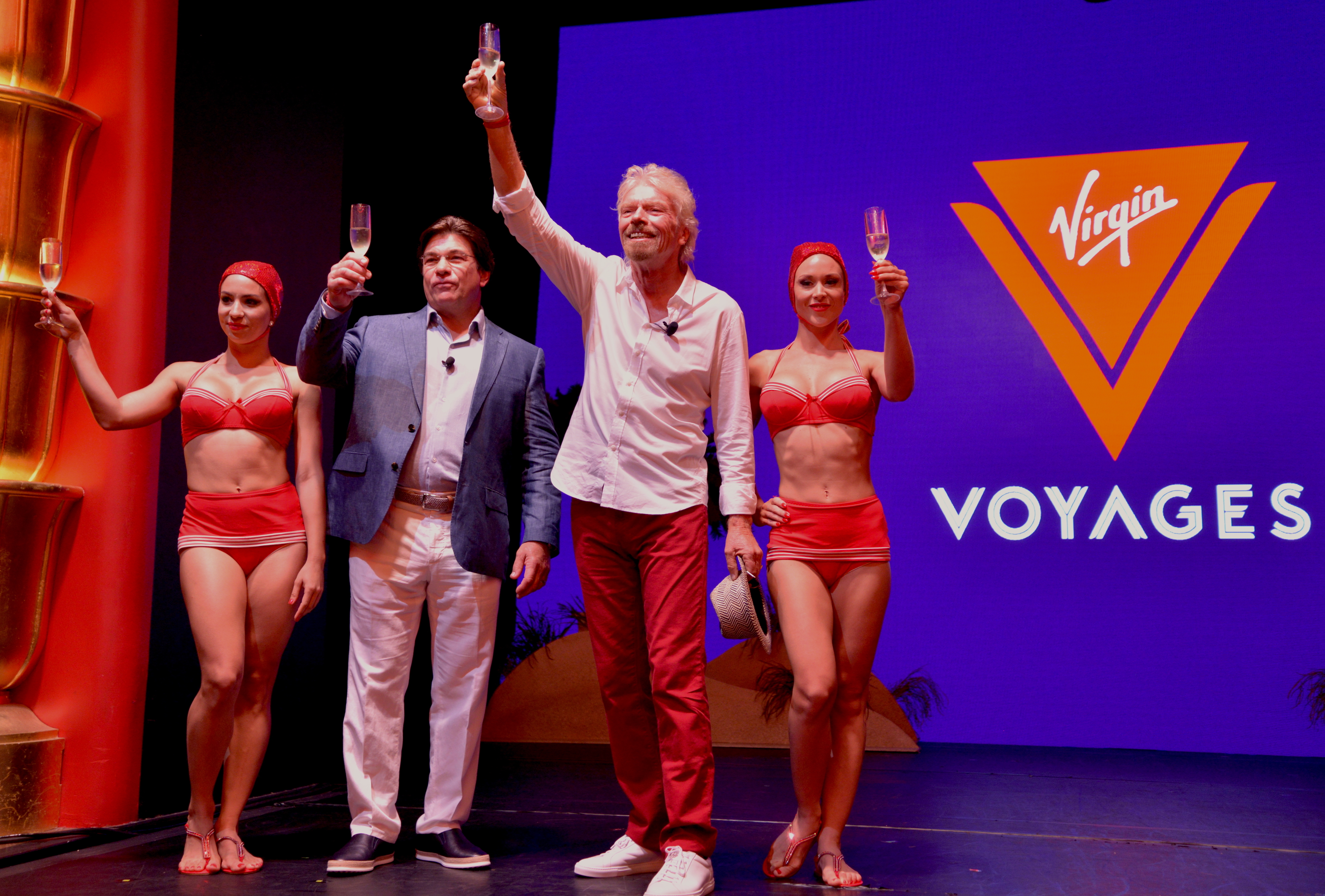 Sir Richard Branson and President & CEO Tom McAlpin unveil Virgin Voyages as the new identity for the company's cruise line.  (Photo: Business Wire)