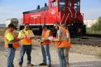 Burlington Junction Railway employees conduct a briefing before a shift. (Photo: Business Wire)