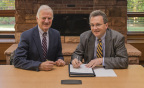 Clarkson University President Tony Collins and Norsk Titanium CEO Warren M. Boley, Jr. Launch Additive Manufacturing Training and Research Initiative (Photo: Business Wire)