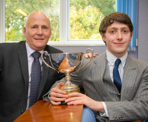 Simon Marshall presents the Guild Trophy to the 2016 Apprentice of the Year, Tom Woods (Photo: Busin ...