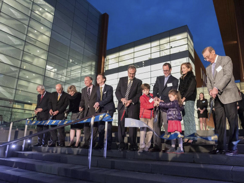 Guests at the ribbon-cutting and dedication ceremony at the University of Michigan's Stephen M. Ross School of Business Friday, Oct. 21, 2016. The event was in celebration of the school's new 104,000 square-foot Jeff T. Blau Hall. Open since Sept. 6, the $135 million building was funded, in part, by a $10 million gift from Jeff T. Blau (BBA '90), as well as a gift by Stephen M. Ross (BBA '62). To date, Mr. Ross has donated more than $313 million to the business school and U-M Athletics, making him the single largest donor in the university's history. RIBBON CUTTING: (Left to right) Former Michigan Ross Deans Joe White, Robert Dolan, Alison Davis-Blake; University of Michigan Regent Andrew Richner; Current Edward J. Frey Dean of the Stephen M. Ross Business School at The University of Michigan Scott DeRue; University of Michigan President Mark Schlissel; Jeff T. Blau with family – Max, Avery and wife Lisa; Stephen Ross (Photo: University of Michigan's Ross School of Business)