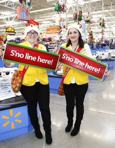 Starting Nov. 4, Walmart's Holiday Helpers will be in stores dedicated to helping customers get through the checkout process faster. Holiday Helpers, ready with candy canes and smiles, will assist customers with finding the shortest line, open registers as needed and will even quickly grab items customers might have forgotten. (Photo: Business Wire)