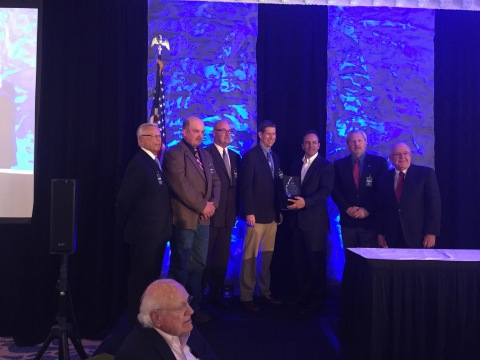 Steve Henry, Hawesville General Manager accepts the Kentucky Manufacturer of the Year award from Gov ...