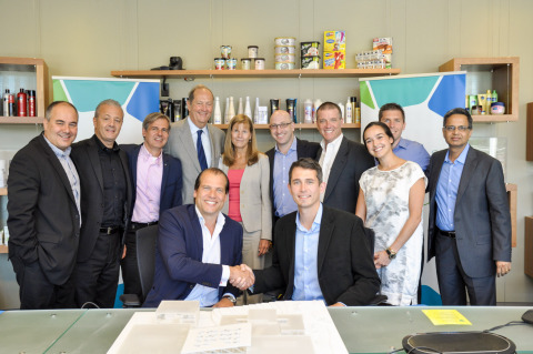 Unilever and Convoy sign the transportation partnership agreement. Seated, from left: Kees Kruythoff ...