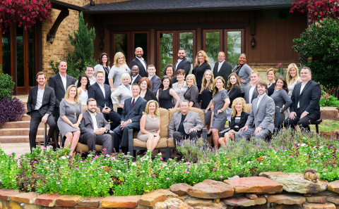 Russell Rhodes (front row, third from left) and The Rhodes Team have joined Berkshire Hathaway HomeServices PenFed Realty Texas. (Photo: Business Wire)