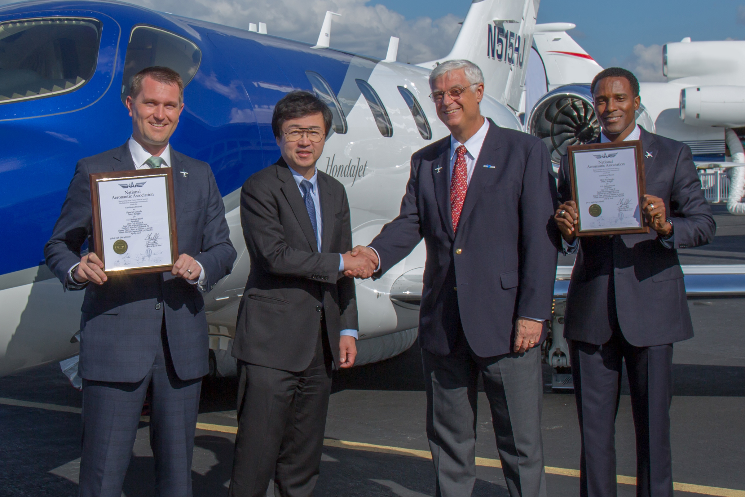 Honda Aircraft Company today announced that the HondaJet has officially secured its first speed records over two recognized courses from Teterboro, New Jersey to Fort Lauderdale, Florida and Boston, Massachusetts to Palm Beach, Florida. (Left to Right: Honda Aircraft Director of Sales, U.S. & Canada, Peter Kriegler, Honda Aircraft President and CEO Michimasa Fujino, National Aeronautic Association President and CEO Greg Principato and Honda Aircraft Regional Sales Manager Glenn Gonzales) (Photo: Business Wire)