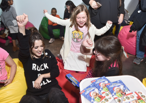 In this photo provided by Nintendo of America, fans gather at Lightbox in New York to see Laura Marano, actress and recording artist, to celebrate girls in gaming. Fans played games such as Mario Party: Star Rush on Nintendo 3DS. Nintendo inspires girls to play the way they want, whether they consider themselves adventurers, creators, heroes or athletes. (Photo: Business Wire)