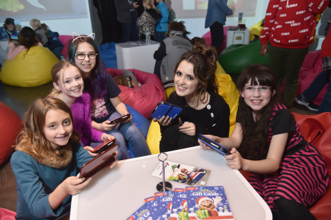 In this photo provided by Nintendo of America, girls play Pokémon Sun and Pokémon Moon for Nintendo 3DS. Game-play activities were part of a larger event hosted by Nintendo, with actress and recording artist Laura Marano at Lightbox in New York on Saturday, Nov. 5. (Photo: Business Wire)