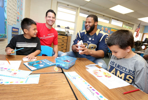 Wells Fargo team members, LA Rams players, including defensive tackle Aaron Donald, and students at  ...