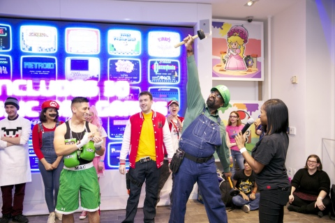 In this photo provided by Nintendo of America, Nintendo fans celebrate the iconic Nintendo Entertainment System, which made its debut in the '80s, at a costume contest celebrating the launch of the Nintendo Entertainment System: NES Classic Edition system, which comes loaded with 30 retro games, at Nintendo NY on Nov. 10, 2016.