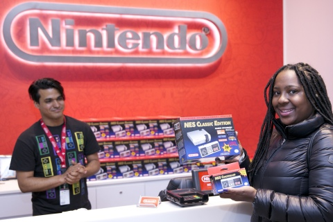 In this photo provided by Nintendo of America, Zuri R. from Brooklyn, NY is the first person to purchase the Nintendo Entertainment System: NES Classic Edition system, which comes loaded with 30 retro games, at Nintendo NY on Nov. 11, 2016.