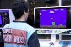 In this photo provided by Nintendo of America, a consumer plays Super Mario Bros., which is one of 30 classic NES games built into the Nintendo Entertainment System: NES Classic Edition system at an event at Nintendo NY on Nov. 10, 2016