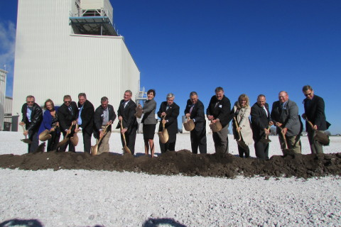 Iowa Governor Terry Branstad and Lt. Gov. Kim Reynolds (center) join Renewable Energy Group leaders  ...